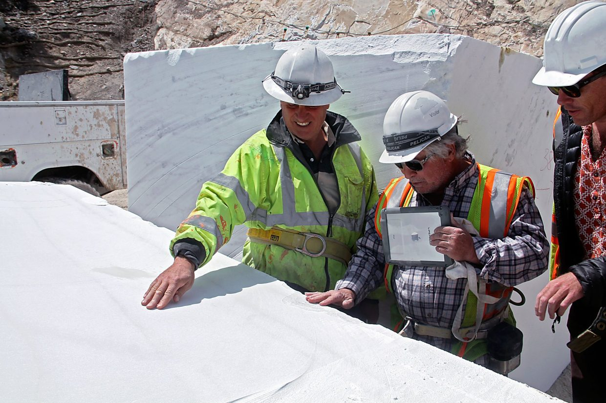 Stefano Mazzucchelli (left) shows off a piece of marble to local sculpture Greg Tonozzi.