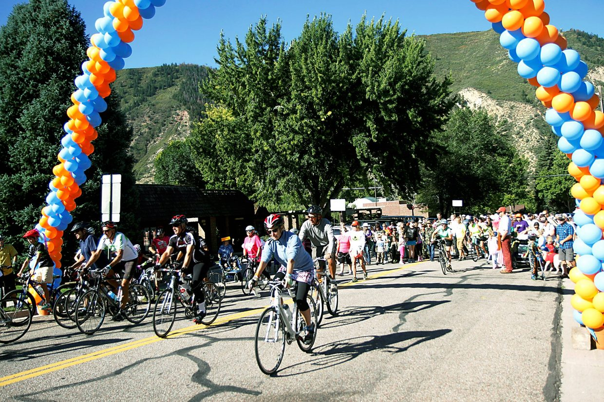Riders participating in the 24.5-mile bike ride lead the way for those doing the 4-mile walkand those doing Peyton's 1.5 Mile Family Parade during Rally the Valley on Saturday morning.