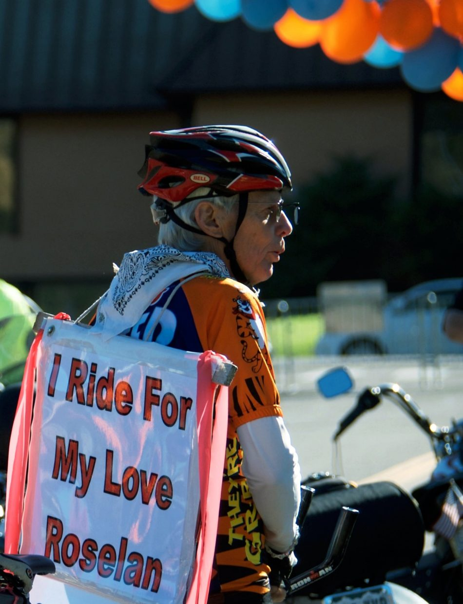 Ron Carr rides his bike at the Rally the Valley in memory of his wife Roselan, who passed away from cancer in December 2013.