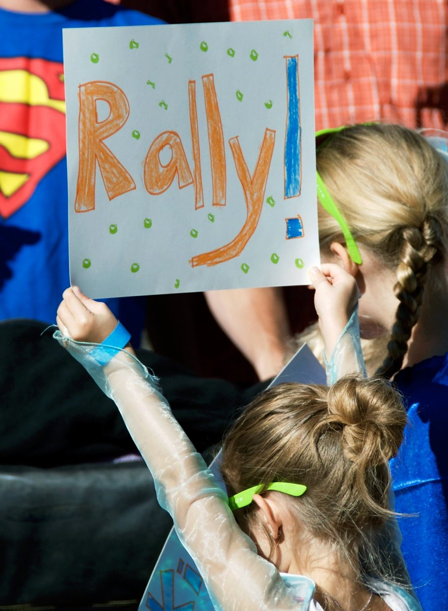 A young Rally the Valley participant holds up a handmade sign before the kids' 1.5-mile parade.
