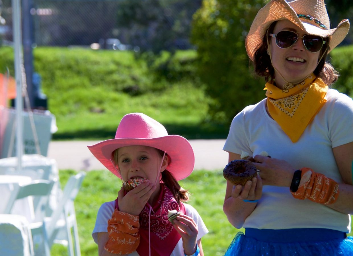 Katie Laven and her daughters Gretchen and Annalise dressed up like cowgirls for the parade.