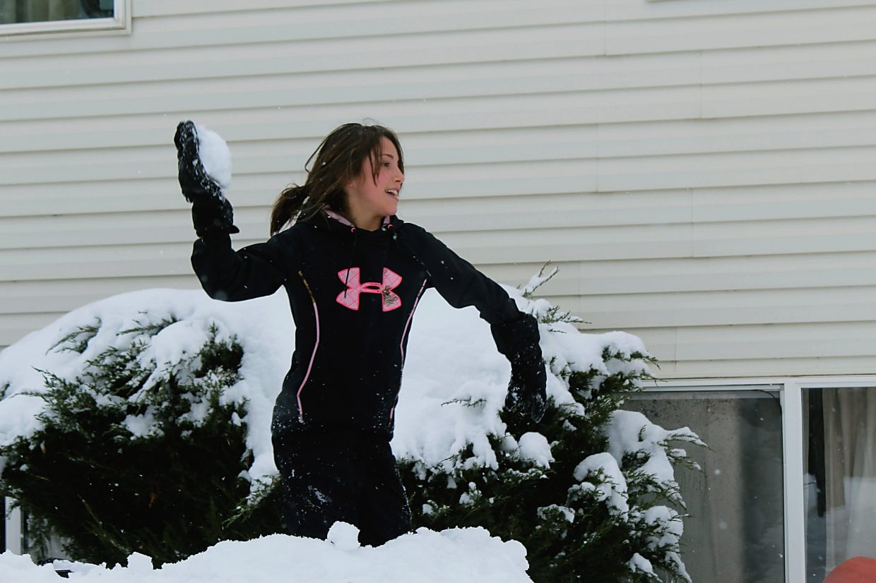 Mackenzie Elizardo hurls a snowball at her brother, Kyle, in Rifle on Monday, Feb. 1.