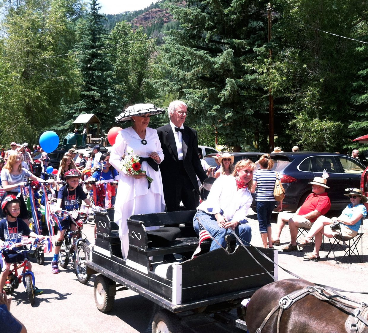 Grand marshals Richard Simpson and Elida Schluter lead the Redstone Fourth of July parade.
