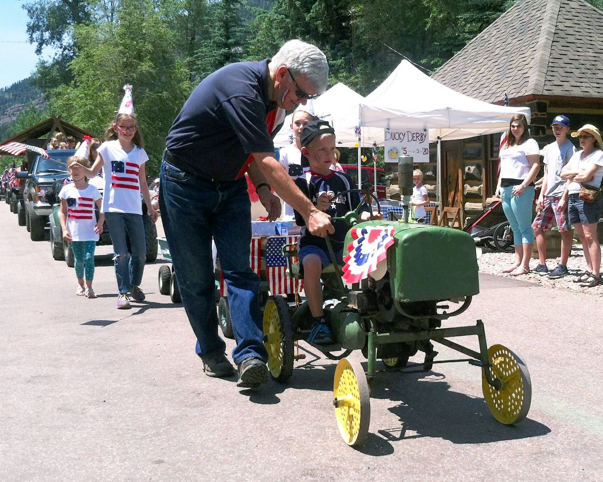 An old-timer, motorized toy tractor was quite the attraction in the Redstone Fourth of July parade.
