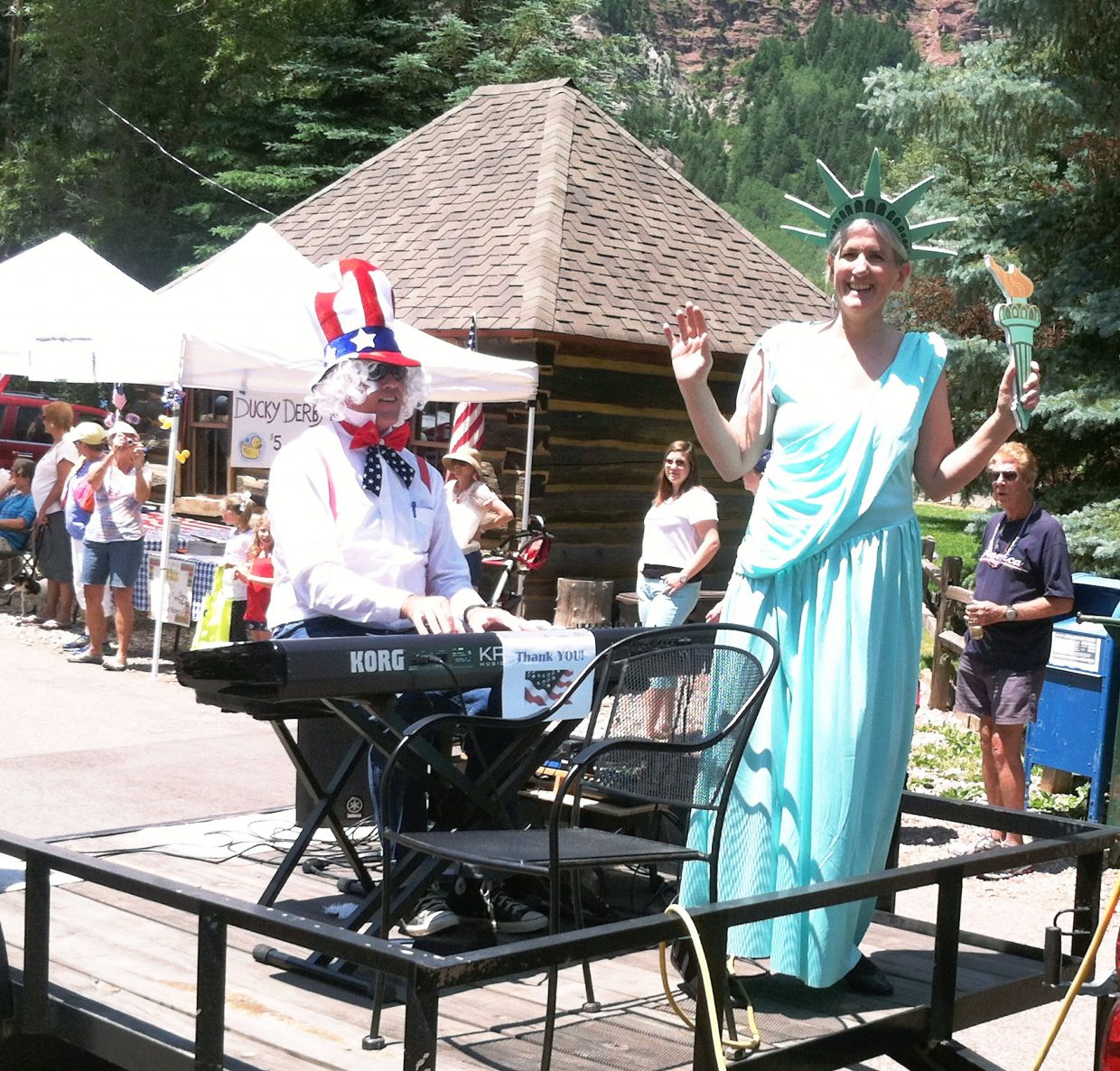 John and Libby Riger dressed as Uncle Sam and Lady Liberty for the Redstone Fourth of July parade, with John playing patriotic songs on his keyboard