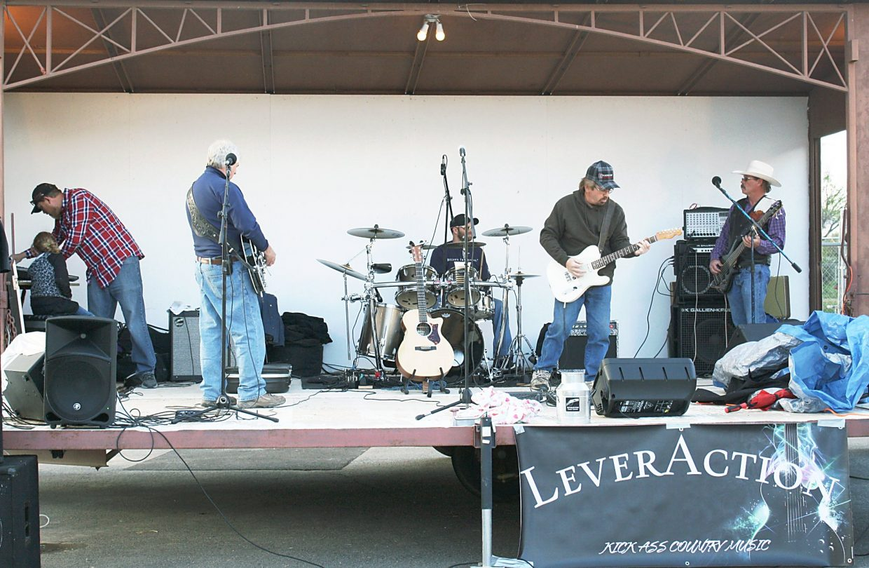 Local band Lever Action warms up before a performance Saturday evening at the 19th annual Rifle Rendezvous.
