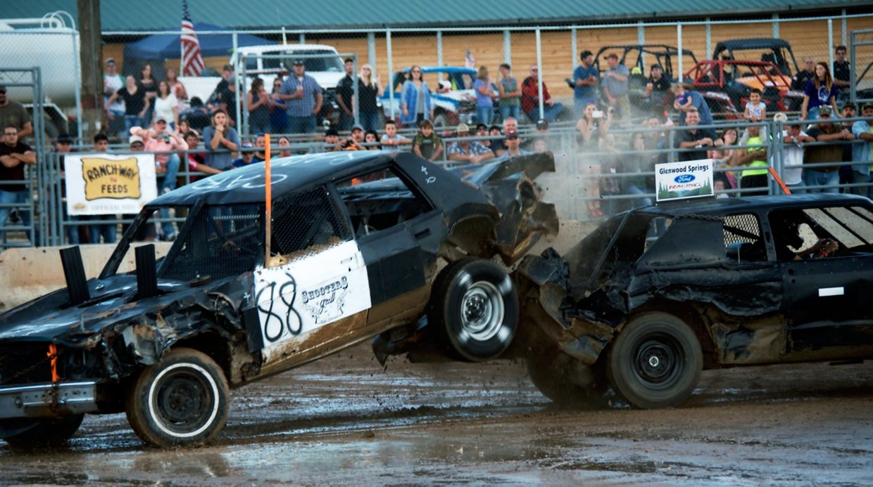 Cars collide at the demolition derby during the Garfield County Fair on Saturday night.