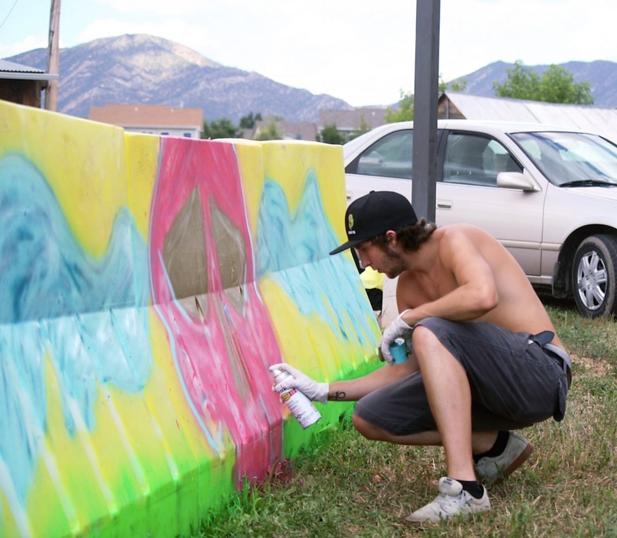 Young, local artist Dylan Bentz works on his piece in the Bookcliffs Arts Center's inaugural Street Art Competition in August. His work is being featured the entire month of September at the Bookcliff's Stone House Gallery.