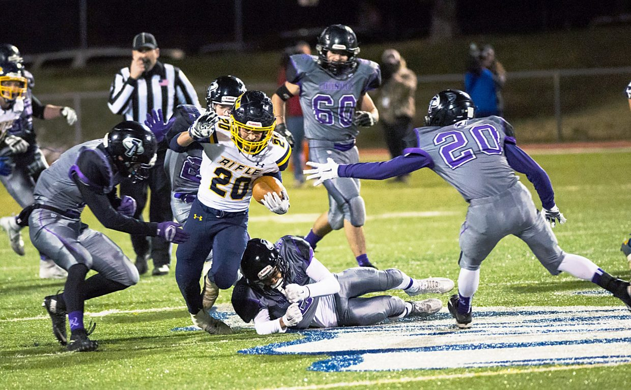 Rifle's Ty Leyba picks up a big chunk of yards in the second half from District 20 Stadium. Leyba finished with more than 50 yards on the ground with a touchdown, but it wasn't enough as the Bears fell to the Thunder, 43-20.