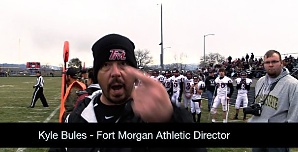 This still frame from a video provided by Align Multimedia shows Fort Morgan High School Athletic Director Kyle Bules confronting videographer Bruce Harper during the state 3A football semifinal game Nov. 22 in Rifle.