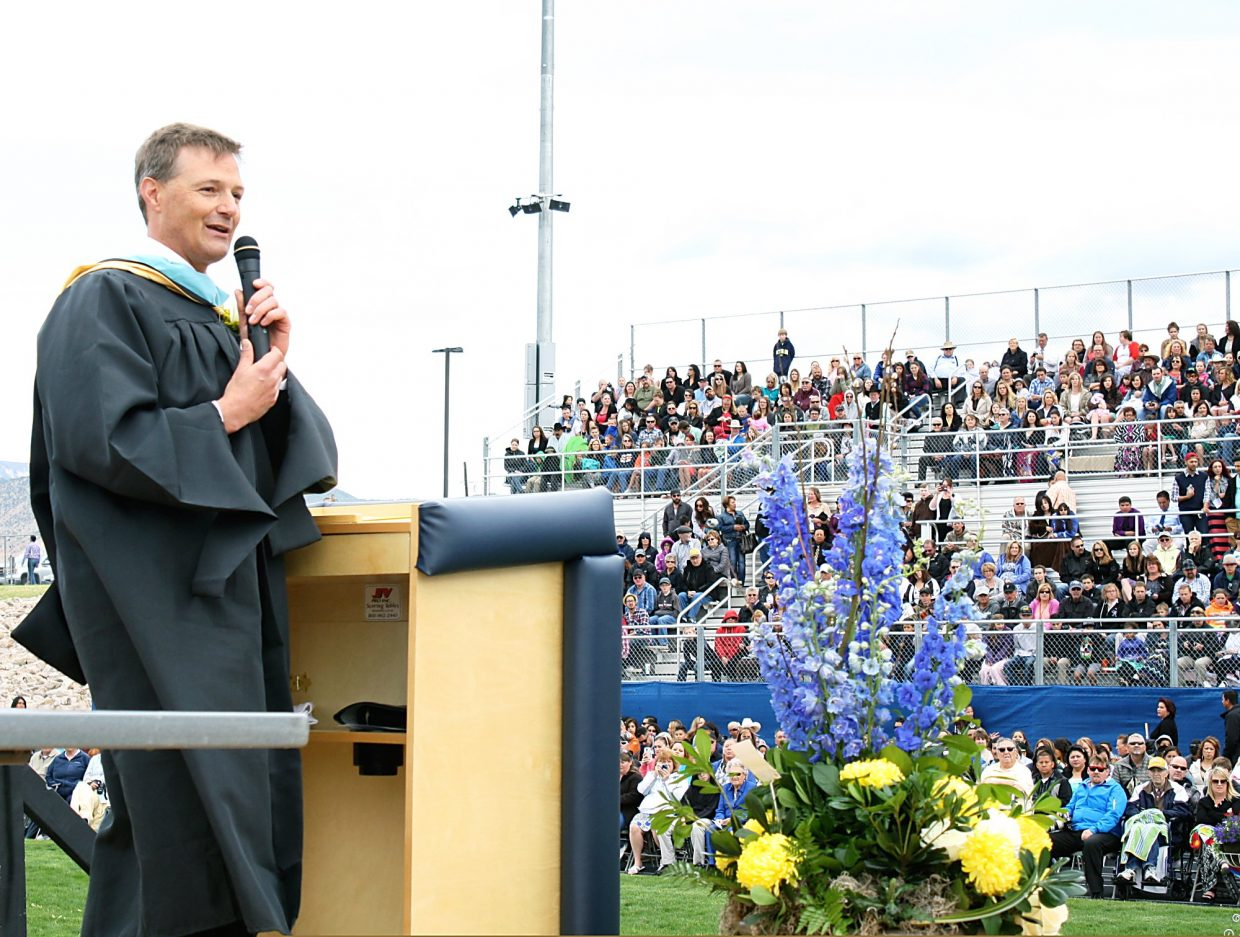 Rifle High School Principal Todd Ellis delivers the opening remarks at the 2015 graduation ceremony Saturday.