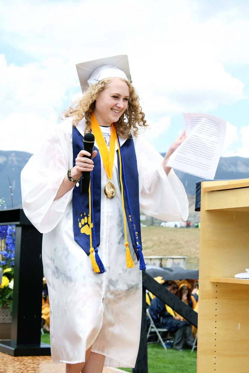 Co-Valedictorian McKenna Smith walks to the podium to deliver her valedictorian's address.