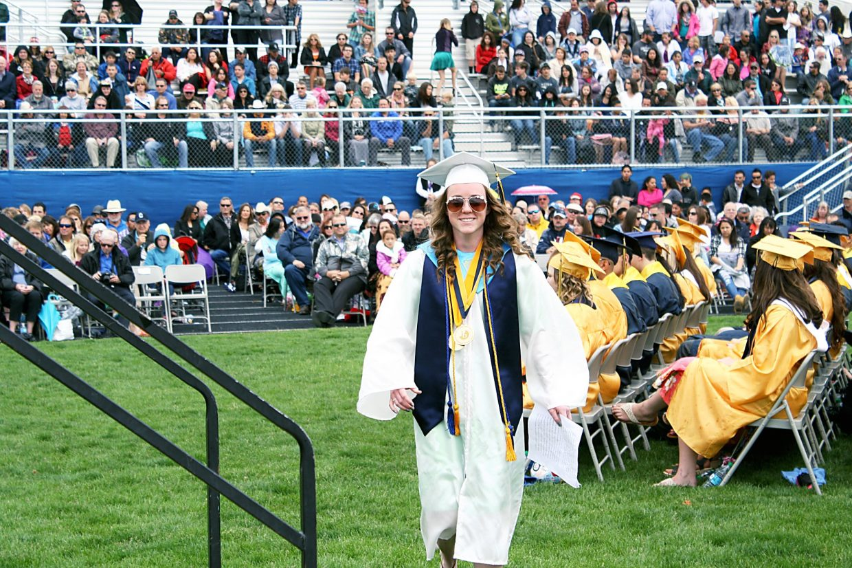 Co-Valedictorian Kelly Coombs walks toward the stage to deliver her valedictorian's address.