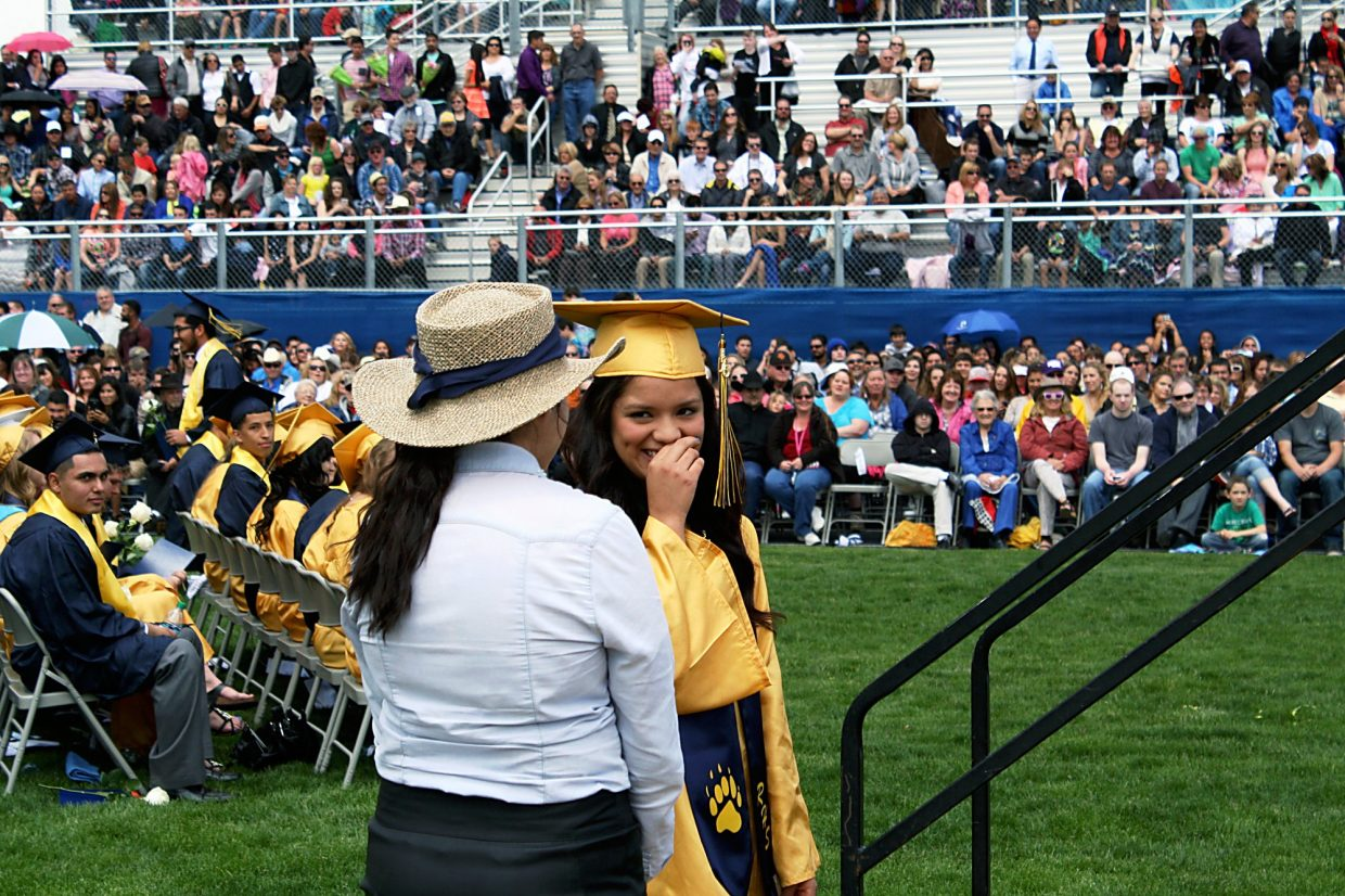 Veronica Santoyo holds back laughter before receiving her diploma.