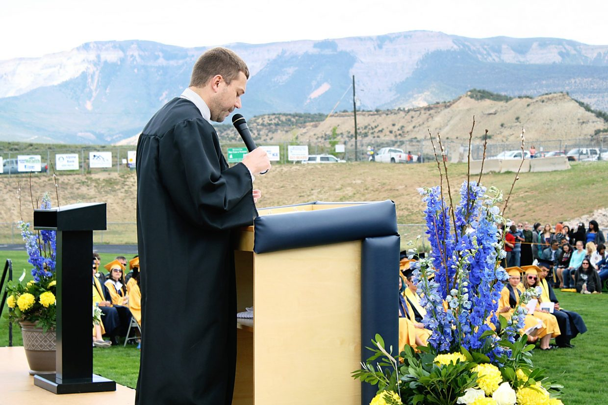 Teacher Kyle Mickelson delivers the commencement address.