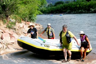 The Edgar family of Basalt, including Derek, left, David, David senior and Gracie pull their raft ashore at the Two Rivers Park boat ramp Wednesday afternoon. The Glenwood Springs Parks and Recreation Department is asking citizens to weigh in on how to improve the riverfront areas in both Two Rivers and Veltus parks.