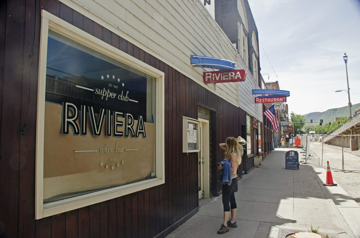 A passerby considers the Riviera's posted new menu.