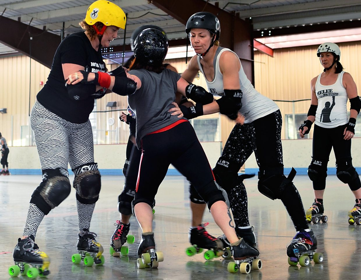 Jessica Montgomery, Diane Chapin, Katie McClanahan and Roslyn Bernstein practice a roller derby drill at the Glenwood Rec Center.