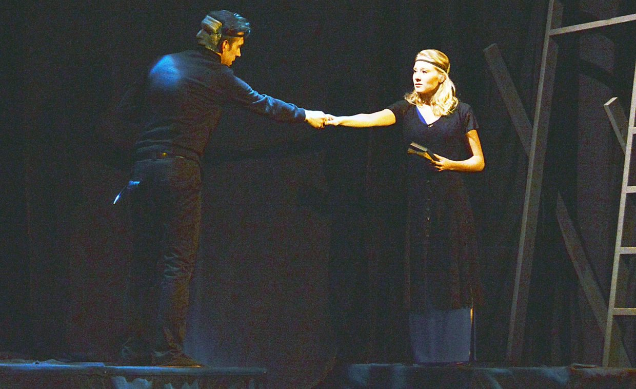 Hamlet (David Pullium) meets with Ophelia (Sophie Sakson) after she denies him her love. Thunder River Theatre's