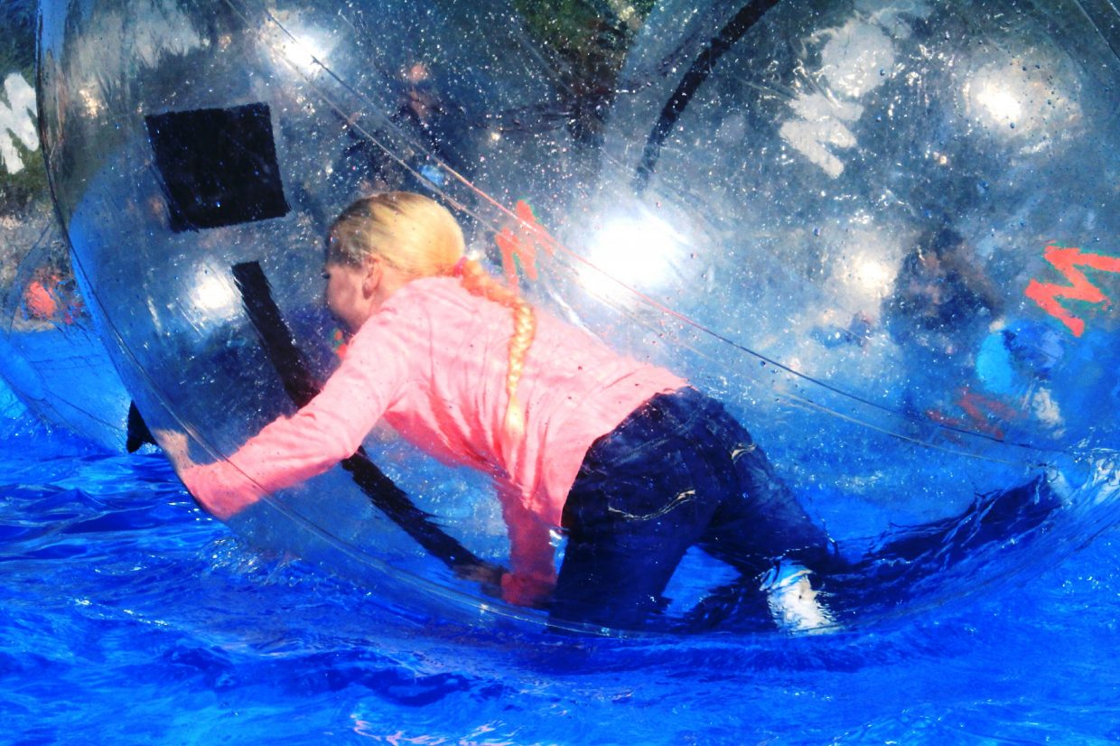 Kids can play in the hamster balls at last year's Oktoberfest in Parachute. This year, the event is two days, with live music and fireworks on Friday and activities in the park on Saturday.