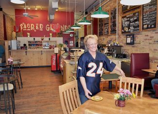 Sally Rue, owner of Sally's Sacred Grounds Coffee House at 725 Grand Ave. in Glenwood Springs, prepares one the tables in the newly expanded seating area. Last week, Rue reconfigured the counter and doubled the seating from 28 to 56 chairs. For the X Games in Aspen, she plans a marathon opening from 7 a.m. Friday to 10 p.m. Sunday. From 5 p.m. to  7 a.m. during that time, she said Sacred Grounds will feature a special, affordable menu with pizza, wings, bagels and pastries aimed at the younger crowd who often attend the games, along with the shop's standard free Wi-Fi.