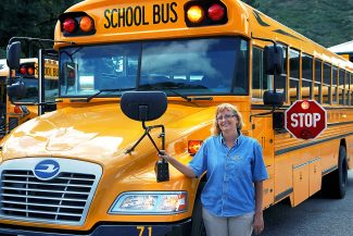 Christopher Mullen Post Independent Kelly Wamboldt stands in front of a school bus she is the Transportation Supervisor for the Roaring Fork School District RE-1, August 20.