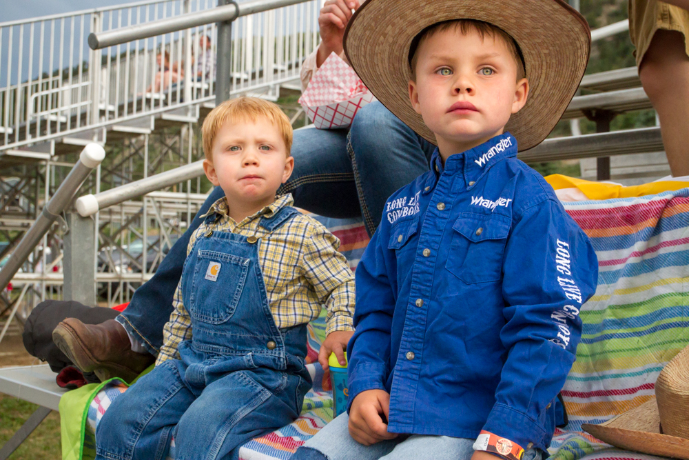 Brothers Kaden and Tate Lasko watch the second week of the Carbondale Wild West Rodeo.