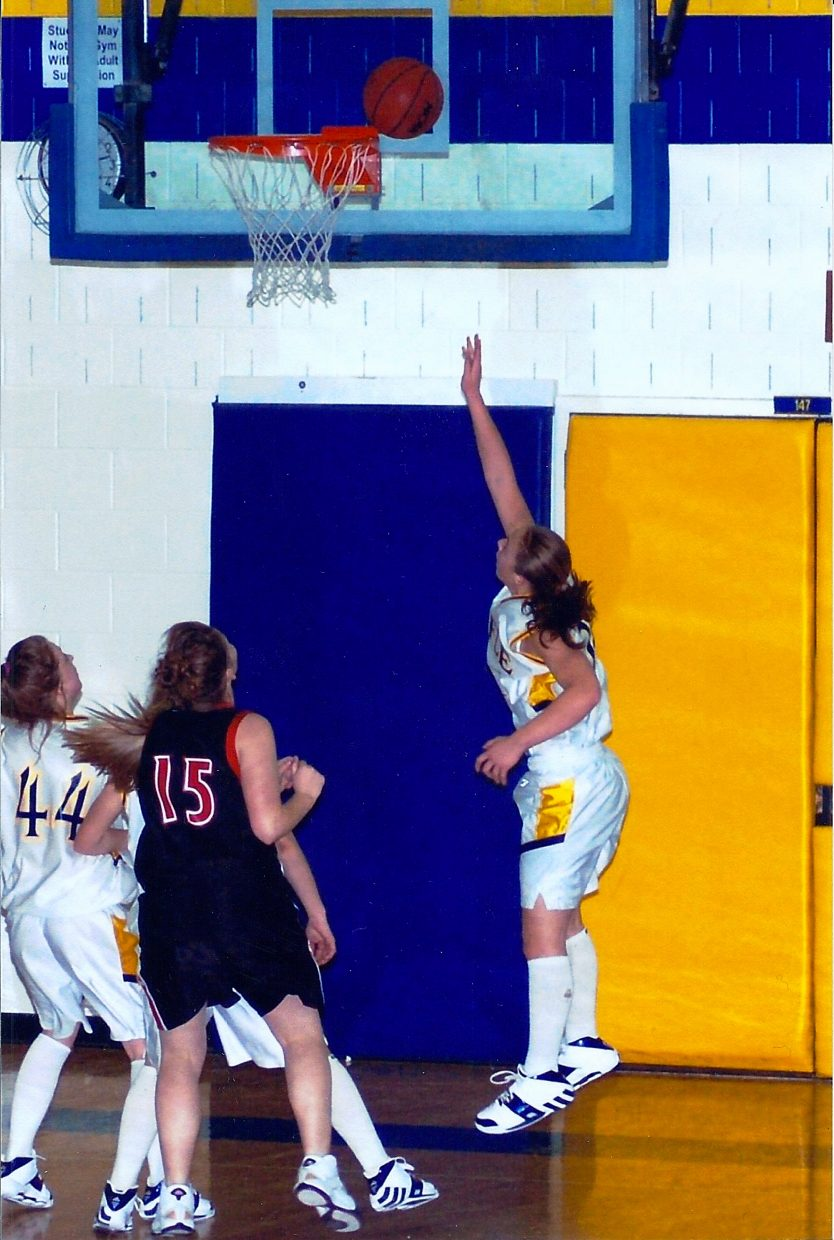 Quincey Snyder shoots a layup in a Rifle High School basketball game. Snyder developed into one of the best players on the varsity team during her junior year in 2008, said Stephanie Heald, former women's varsity basketball coach at Rifle High School.