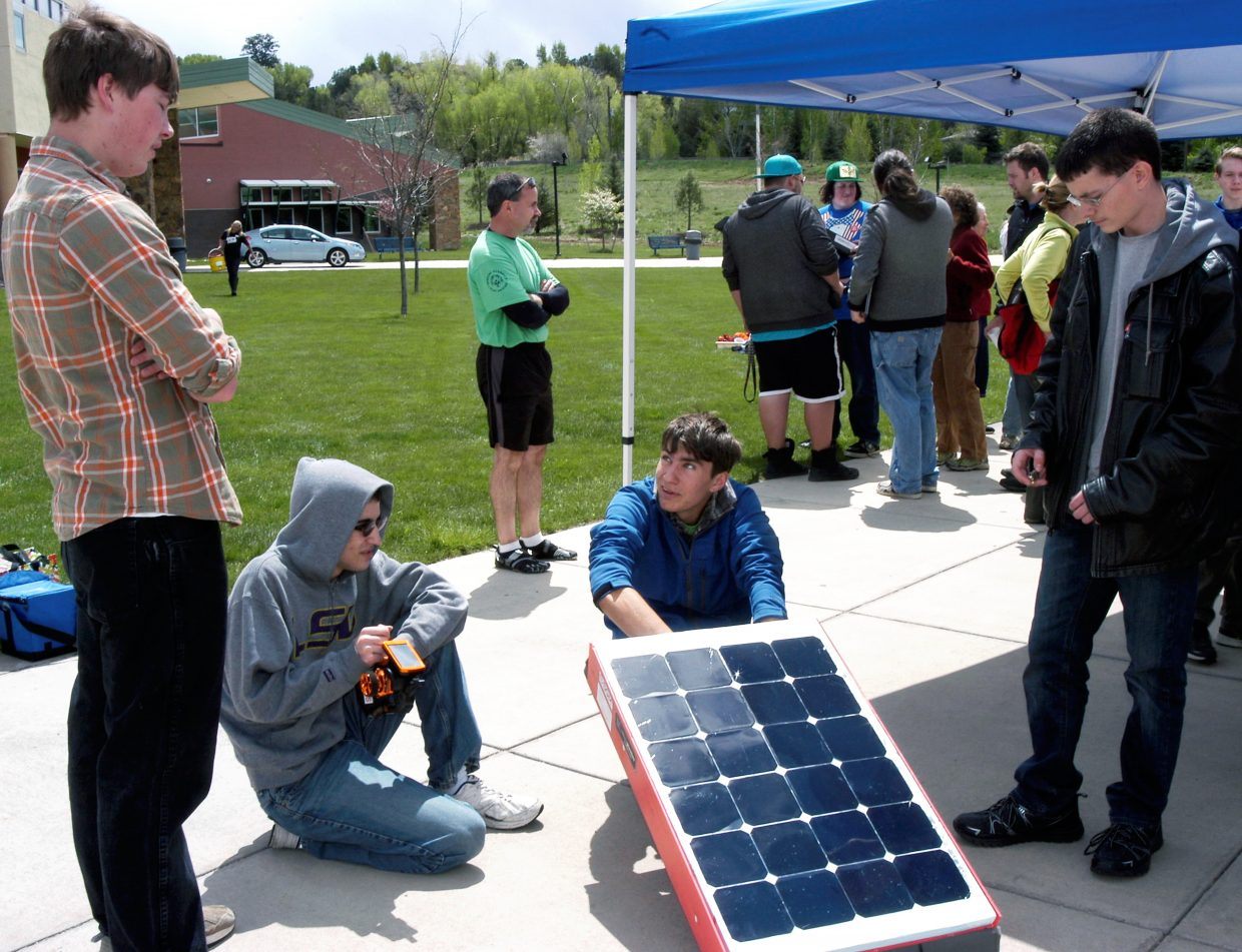 Glenwood Springs High School Solar Rollers team members, from left, Forest Rappe, Ryan Scott, Anthony Parker and Branden Zimmerman, with their solar car.