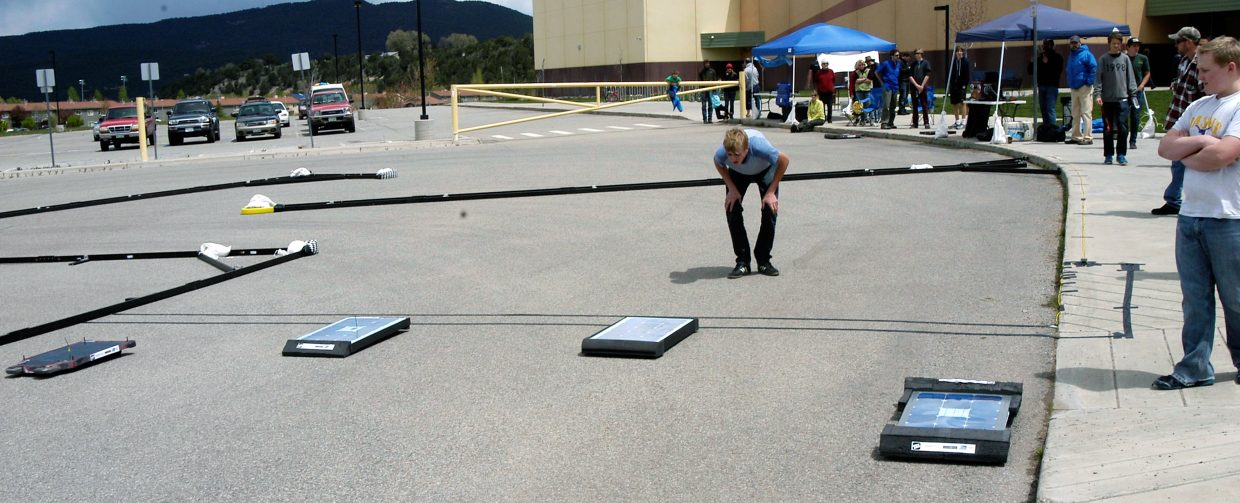 Students and a handful of spectators get ready for one of the solar car races to begin during the Energetics Education Solar Rollers event at Roaring Fork High School in Carbondale on Saturday.