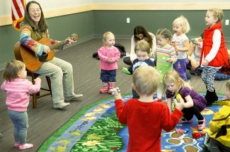 Christopher Mullen Post Independent Anna Stange sings to a room full of kids and adults at the Glenwood Springs Library Tuesday morning. Singing Story time with Anna Stange will be at New Castle Branch Library at 6:30 PM April 2.