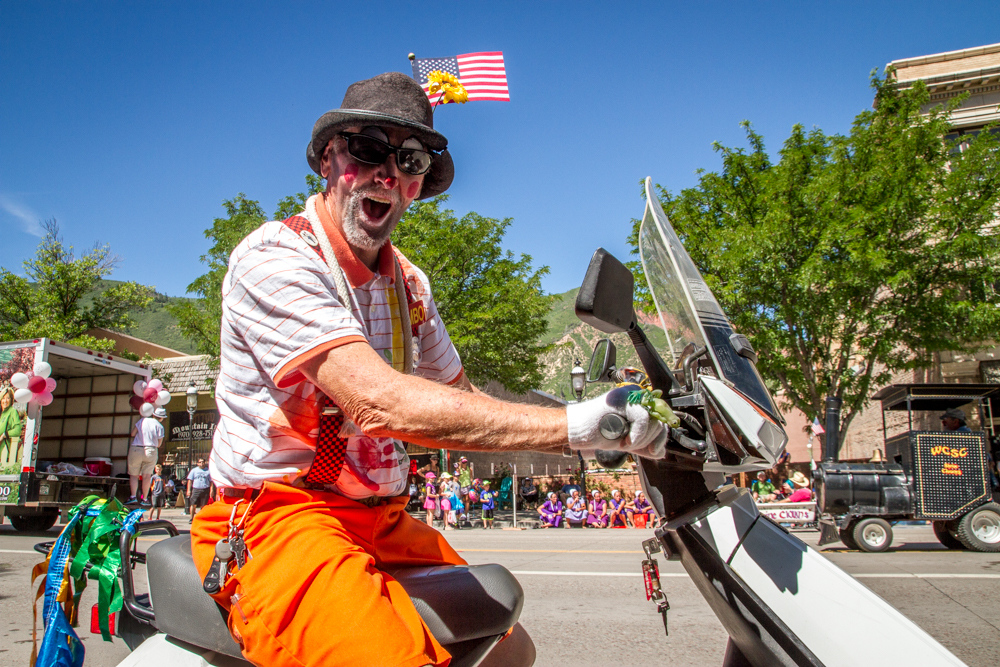 A festive parade clown rode through the Strawberry Days Parade in style Saturday morning.