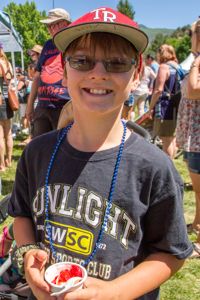 Eleven year old Tyler Madden took advantage of the free ice cream on a hot day after the parade Saturday morning.