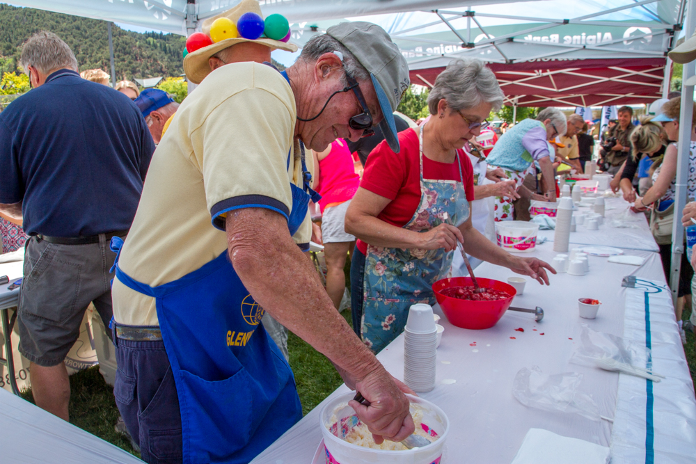 Volunteers with the Glenwood Springs Rotary handing out ice cream and strawberries at Sayre Park.