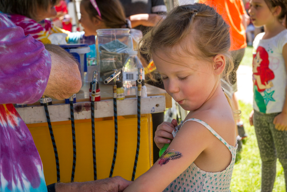 Zoe Kanble (3) looks in awe at her new butterfly tattoo.