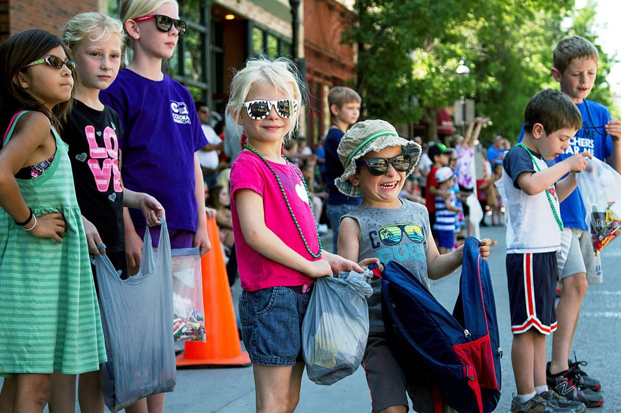 Excited kids wait anxiously to collect as much candy as possible during the Strawberry Days Parade on Saturday morning.