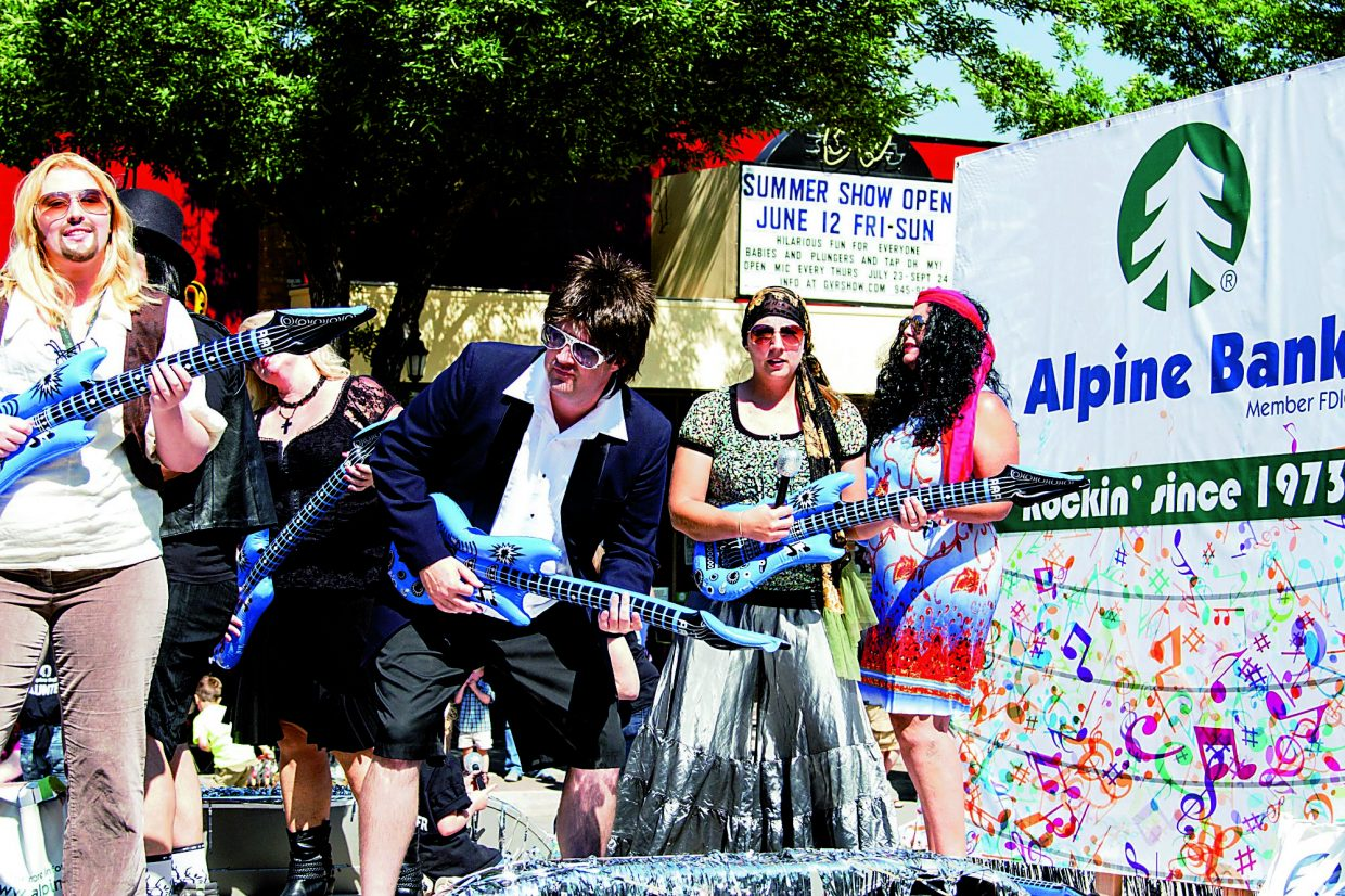 The represntitives of Alpine Bank rock out loud and proud on their Strawberry Days float Saturday Morning.