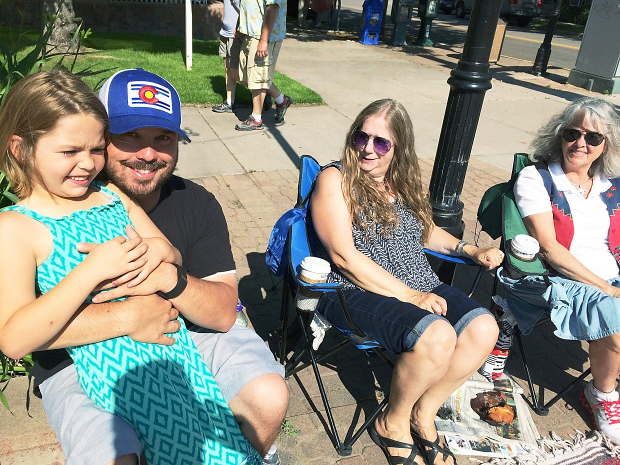 Pyper, Ty, Melissa English and Joey Antonides (left to right) enjoy Saturday's Strawberry Days Parade.