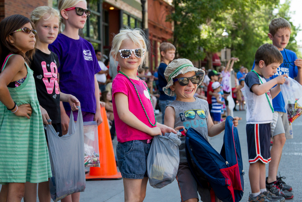 Excited kids wait anxiously to collect as much candy as possible during the Strawberry Days Parade on Saturday Morning. June 20, 2015.