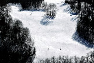 Christopher Mullen Post IndependentSnowboarders and skiers go down a run at Sunlight Mountain Tuesday afternoon.