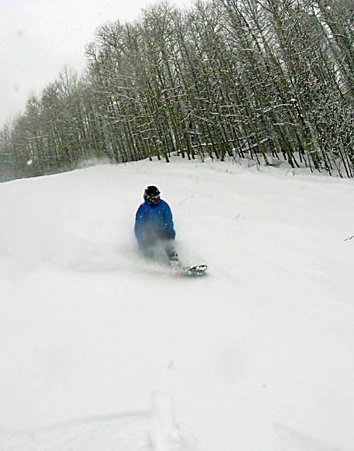 A boarder rides down a run on Christmas Day at Sunlight Mountain Resort south of Glenwood Springs.