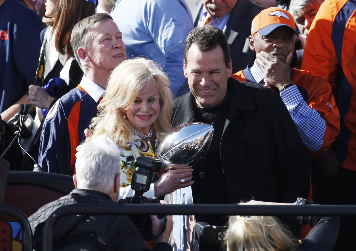 Denver Broncos head coach Gary Kubiak, right, poses for photograph as Annabelle Bowlen, wife of team owner Pat Bowlen, holds the trophy at a rally following a parade through downtown Tuesday, Feb. 9, 2016 in Denver. Fans crowded into Denver's downtown to salute the Broncos for the team's victory over the Carolina Panthers in Super Bowl 50. (AP Photo/David Zalubowski)