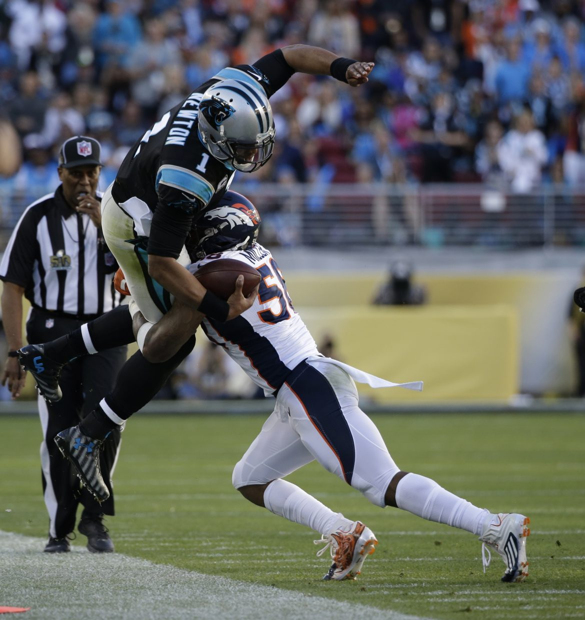 Denver Broncos' Von Miller (58) tackles Carolina Panthers' Cam Newton (1) on a run during the first half of the NFL Super Bowl 50 football game Sunday, Feb. 7, 2016, in Santa Clara, Calif. (AP Photo/Marcio Jose Sanchez)