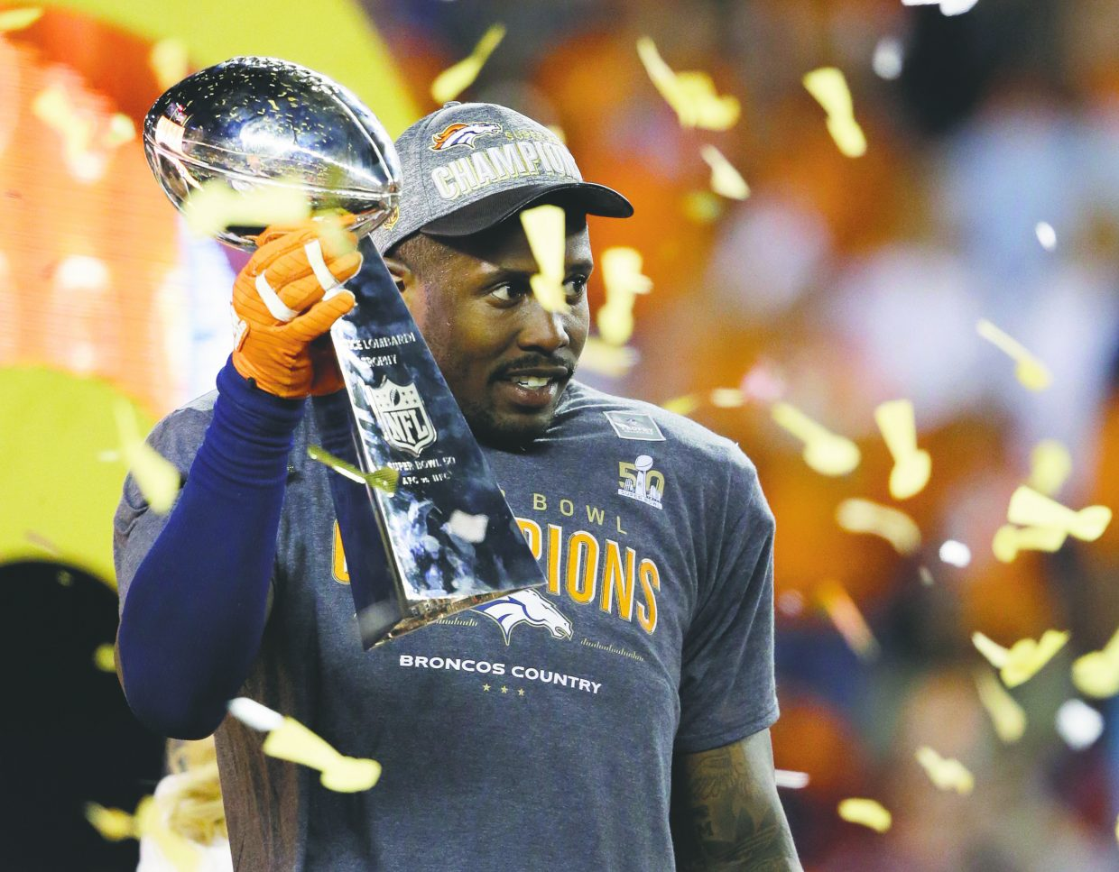 Denver Broncos' Von Miller holds the trophy after the NFL Super Bowl 50 football game Sunday, Feb. 7, 2016, in Santa Clara, Calif. The Broncos won 24-10. (AP Photo/Ben Margot)
