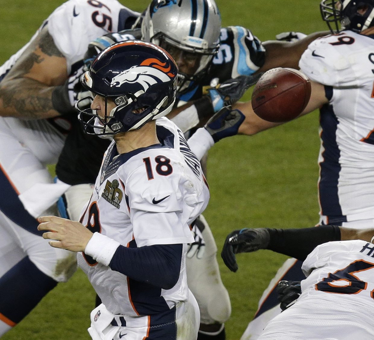 Denver Broncos' Peyton Manning (18) loses the ball during the second half of the NFL Super Bowl 50 football game against the Carolina Panthers Sunday, Feb. 7, 2016, in Santa Clara, Calif. The Panthers recovered the fumble. (AP Photo/Charlie Riedel)