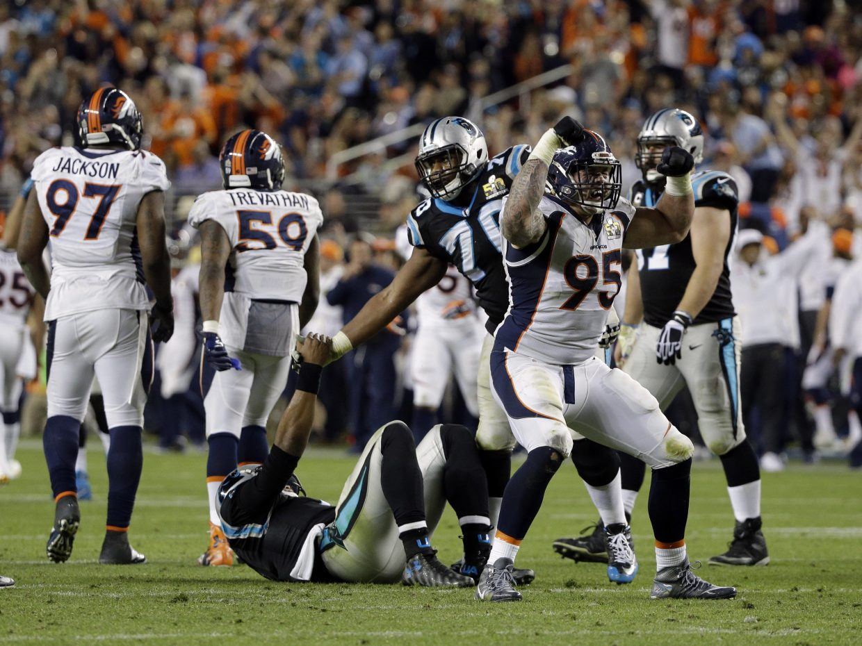 Denver Broncos' Derek Wolfe (95) celebrates after sacking Carolina Panthers' Cam Newton (1) during the second half of the NFL Super Bowl 50 football game Sunday, Feb. 7, 2016, in Santa Clara, Calif. (AP Photo/Julie Jacobson)