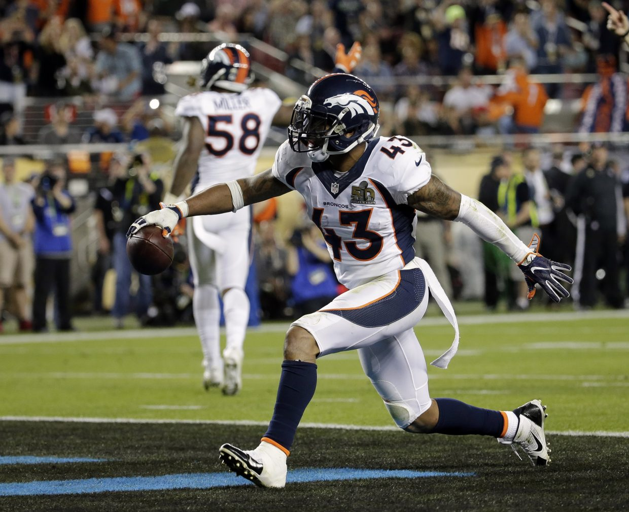 Denver Broncos' T.J. Ward (43) celebrates after recovering a fumble during the second half of the NFL Super Bowl 50 football game Sunday, Feb. 7, 2016, in Santa Clara, Calif. (AP Photo/Matt York)
