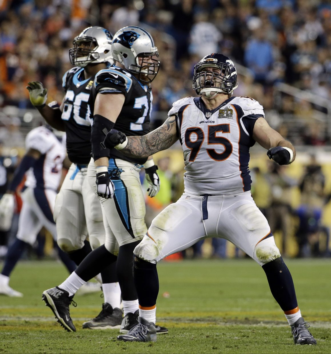 Denver Broncos' Derek Wolfe (95) celebrates after sacking Carolina Panthers' Cam Newton (1) during the second half of the NFL Super Bowl 50 football game Sunday, Feb. 7, 2016, in Santa Clara, Calif.  (AP Photo/Jeff Chiu)
