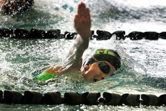 Emma Barsness of Team Sopris swims in the Western Slope IMX Challenge girls 9- to 10-year-old 100-yard freestyle race, in which she finished third Sunday at the Glenwood Springs Community Center pool.
