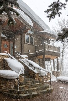 A home for sale on Forest Road sits under a freshly fallen blanket of snow Friday in Vail.